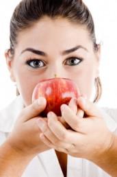 Female Holding Apple Near Her Faceby imagerymajestic
